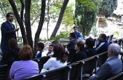 Pastor-Steven-Khoury-preaching-at-service-at-Garden-Tomb-in-2007.-Courtesy-of-Steven-Khoury-300x196